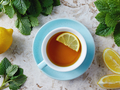 The tea contains aluminum and in combination with aluminum citrate with lemon