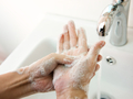 A woman with phobia, forcibly washing her hands